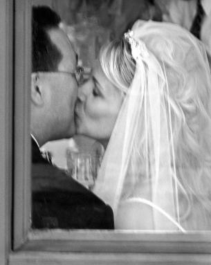 A quick sneak kiss at the reception